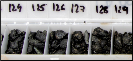 RC drill chips from LAARC003 showing sulphide rich mineralisation