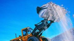 Backhoe lifting rubble